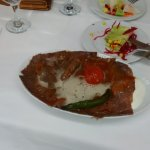 Iskender Kebab with melted butter topping