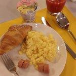 Scramble egg, hotdog, red orange and yoghurt is good