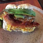 A soft, warm fluffy homemade roll loaded with scrambled egg, crispy bacon and tree ripened avoca