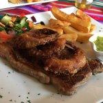 Awesome steak, prepared just right. Beautiful chimichurri sauce.