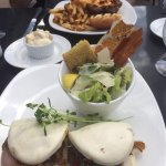 Close up of Bulgogi beef and Caesar salad.