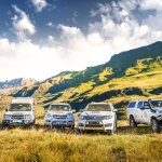 A few of our Vehicles - what an awesome backdrop