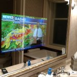 TV in the bathroom mirror.  Unexpected!