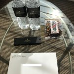 Welcome letter, water, sweet (chocolate), and savory (arare) treats upon check-in with Ambassado