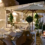 New Sunset Bar Terrace with view into our restaurant by night, enjoy the romantic atmosphere