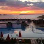 Sunset. Looking over the pool, beach beyond then the sea!