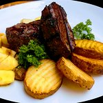 Venison meat roasts with boletus (mushrooms)  and apples