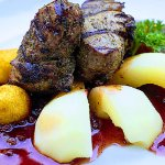 Boar meat roast praised by Grand Duke Gediminas with cowberry sauce and sweet pear