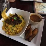 This dish is not on the menu but it was chicken with rice topped with churrasco