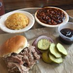 Pulled pork lunch special with baked beans and corn pudding.