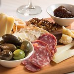 Traditional Tuscan antipasti including artisan cured meats, cheeses, olives and grilled crostini
