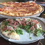 Top is a regular pizza with proscuitto. The bottom one is the crispy Artisan pizza with prosciut