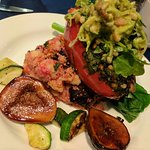 Spinach-stuffed red pepper with pine nuts, zucchini/avocado salad, couscous with beets, roasted