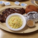 12 ounce ribeye with cole slaw and baked sweet potato