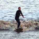 An intrepid Bore surfer.