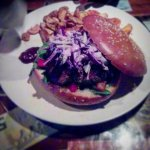 red cabbage and yoghurt coleslaw on a pork burger