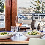 Dine by the window and gaze at Australia's most iconic beach