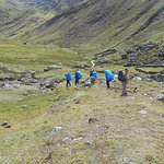 Porters carrying all our equipment on their backs along the Lares Trek.