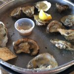 In the location of an old well loved oyster joint. The oak smoked grilled oysters were $17.95 fo