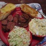 Smoked Sausage plate with cole slaw and potato salad