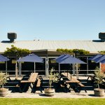 The outdoor tables are a wonderful place to soak in the summer sun & take in gorgeous vineyard v
