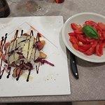 Main course: duck tagliata with grana padana, red cabbage, balsamico, and side dish tomato salad