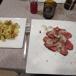 Main course: veal tagliata with fresh black truffle, and a side dish of roast potatoes