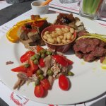 Accoglienza: beef tartar with lemon, pork with tomatoes/capers, roasted pork, meatloaf with oran