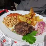 Super Dario: beef burger, sage and garlic roasted potatoes, tomato stew, onion and white beans