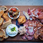 Charcuterie board - a selection of cured meats and pates