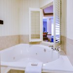 Spa King Suites feature large Jacuzzi tub with TV view plus separate shower.