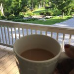 My morning coffee on the porch overlooking the gardens,