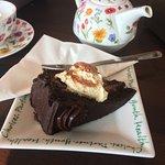 Chocolate cake, cream, and earl grey tea.