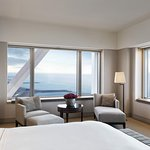 Enjoy a stunning view of the sea from this guestroom at Hotel Arts Barcelona
