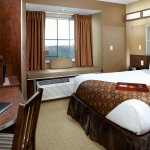 1 Queen Bed Room with free buffet breakfast, free Wi-Fi, HDTV, refrigerator, and microwave.