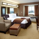1 Queen Bed Room with free buffet breakfast, free Wi-Fi, HDTV, oversized chair & kitchenette