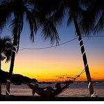 Life is good Laying in a Hammock at the beach - sunset in Coco
