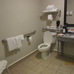 Handicapped bath is very spacious. (Shower chair in corner.)