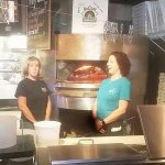 Nice Lady on left and Amber on the right in front of the Wood Fire Pizza Oven!