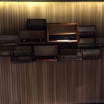 Old radios as wall decor opposite elevators