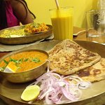 Lassi and paratha with black dal(?)
