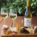 A cheese platter with our famous Chardonnay Pinot Noir