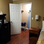good size closet with ironing board and iron