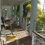 Balcony looks at waterway and Clearwater Paddle Board Surf Shop and fising pier