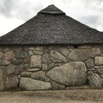 One of the 17th century thatched roof stone cottages