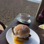 Sausage & egg breakfast bap with coffee and a great view!