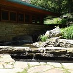 "Kentuck Knob itself with home emerging from it along with miniature ""Falling Water"" falls"