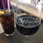 Assortment of drinks - wine and coke w/lemon pictured