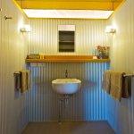 Safari tent bathroom, includes basin, shower & toilet.