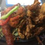 Mixed platter- lamb kebabs, chicken tikka , bhaji , samosa with tamarind and mint chutney on siz